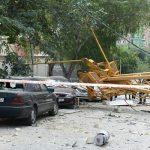 Подъемный кран упал на жилое здание