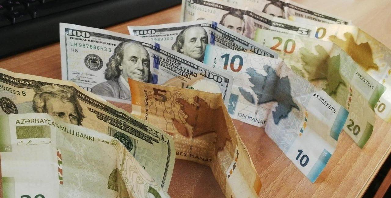 realnaya stoimost manata po otnosheniyu k dollaru